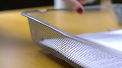 Time lapse of papers being put into and taken out of the IN box on a desk - stock footage