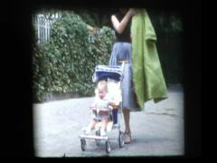Glam 50's woman with baby in stroller Stock Footage