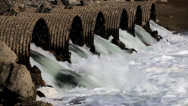 Stock Video Footage of Raging Floodwater Drains Trhough Culvert Pipes