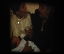Grandmother watches mom feed baby baby bottle Stock Footage