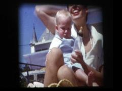 Happy 50s Mom burps baby girl after feeding bottle Stock Footage