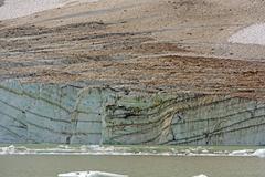 Glacial ice face on a glacial lake Stock Photos