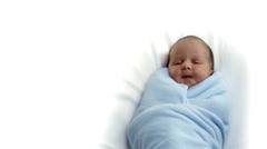 Baby boy sleeps in blankets - stock footage