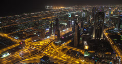4K aerial time lapse of Dubai and it's busy freeways at night Stock Footage