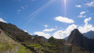 Stock Video Footage of Machu Picchu wide angle in time lapse with clouds looking into Sun