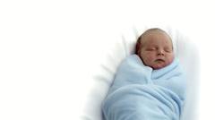 Baby sleeps in blankets. - stock footage