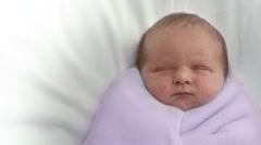 Baby is sleeping in blankets - stock footage