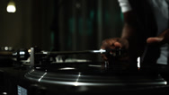 Stock Video Footage of Close up of a DJ's hands spinning records at a party