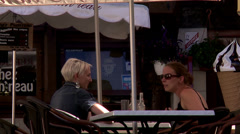 Women talking at outdoor cafe - France Stock Footage