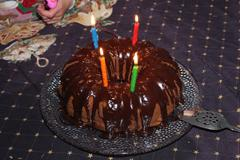Chocolate Bundt Birthday Cake with Candles Stock Photos