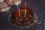 Stock Photo of Chocolate Bundt Birthday Cake with Candles