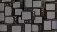 A wall full of old TVs flashing random images Stock Footage