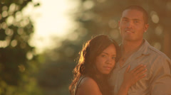 Beautiful Diverse Couple hug and look into camera Stock Footage