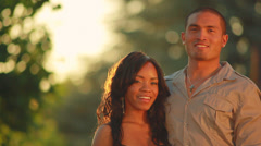 Couple hugs in park. Stock Footage