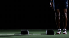 An African American athlete works on speed and agility while doing box jumping - stock footage