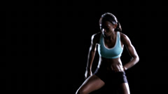 A female athlete works on speed and agility while doing box jumping - stock footage