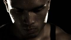 Sweaty Athlete Looks at Camera Stock Footage