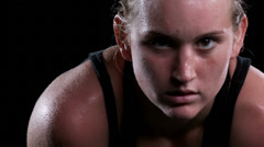 A female athlete breathes heavy and sweats after an intense exercise Stock Footage