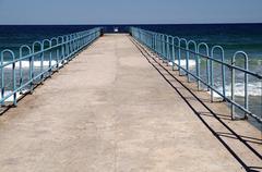 Small seaside pier Stock Photos