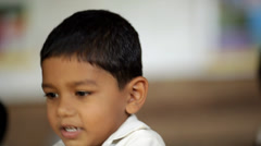 Closeup of young Indian boy playing games in preschool class in rural India Stock Footage