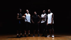 Slow zoom in of a group of basketball players standing in a line Stock Footage