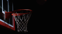 Close up of a basketball hitting the rim of the hoop and bouncing away Stock Footage