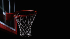 Close up of a basketball falling through the net of the hoop for a swoosh - stock footage