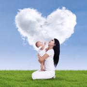 Cute baby and his mother outdoors Stock Photos