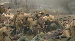 Soldiers rolled on the battlefield gun and shoot Stock Footage