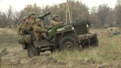 Soldiers attack the enemy. Firearms are used, tanks and heavy weapons. Stock Footage