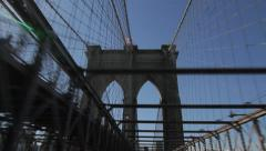 Driving under arch of Brooklyn Bridge Stock Footage