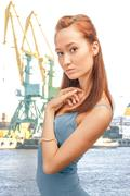 Beautiful lady in the merchant seaport Stock Photos