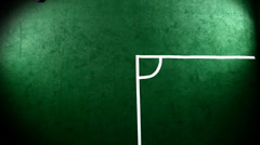 Soccer athlete kicks a corner kick. Wide shot as seen from above - stock footage
