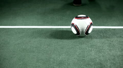 Soccer player kicks ball up into his hands and looks into camera, focused. - stock footage