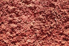 texture of red bumpy cement wall - stock photo
