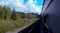 Trans-Siberian Railway train passing by a landscape with forest Stock Footage