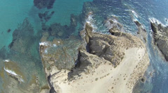 Aerial view crag, cove, small bay, cliff - stock footage