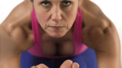 Close up shot of a focused white female doing yoga poses Stock Footage