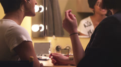 Female model getting her eyebrow penciled in by a female Stock Footage