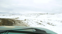 Off-road driving through the snowy highland Stock Footage