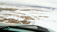 Off-road car riding through the snowy mountain plateau Stock Footage