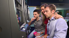 Group of Friend Playing with Slot Machines Stock Footage