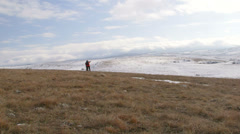 Travellers on the snowy mountain plateau Stock Footage