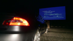 Drive-in movie theater at night - stock footage