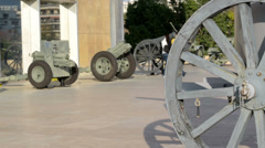 Couple walking among cannons at the military museum Stock Footage