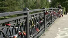 Bridge in Irkutsk with love locks Stock Footage