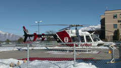Emergency rescue AirMed helicopter at hospital  Stock Footage