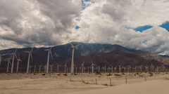 Panning time lapse of clouds passing over wind turbines in Palm Springs Stock Footage