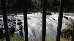Waterfall with fence in foreground (86) Stock Footage