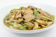 Fried sweet pepper with pork Stock Photos